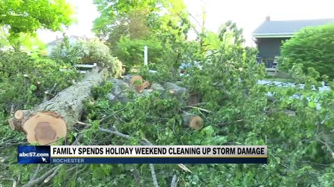 Families spend Memorial Day weekend cleaning up storm damage...
